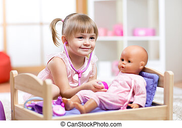 Cute Child Playing Doctor with doll Toy