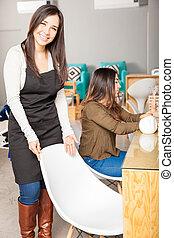 Cute nail salon worker greeting customers