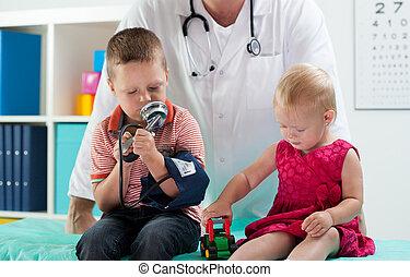 Cute siblings sitting at pediatrician