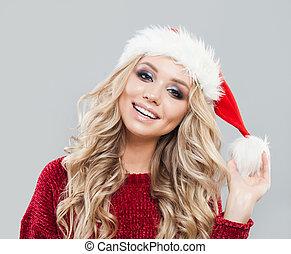 Cute woman wearing santa hat. Christmas woman in red sweater