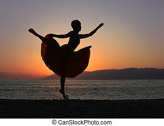 Dancing woman on the beach