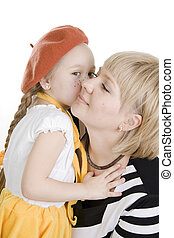 Daughter kissing her mother.