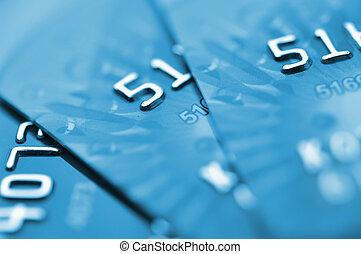 Debit cards in blue tone. Macro shot. Selective focus.