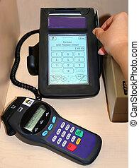 swiping debit card on terminal