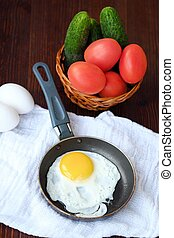 Delicious breakfast eggs with vegetables on the table