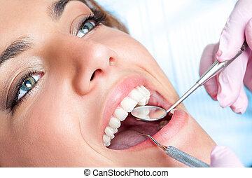 Dentist working on girls teeth