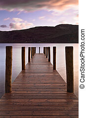 Wooden landing stage at Derwent water on a calm morning