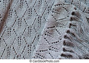 closeup detail of woven handicraft knit woolen design texture. Fabric gray background