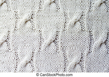 Detail of woven handicraft knit woolen design texture and knitting needle. Fabric white background