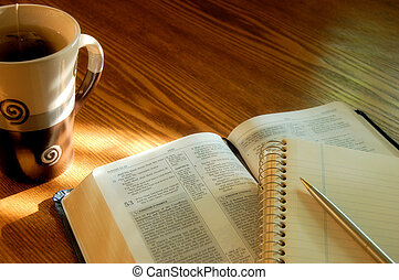 Open Bible with tea cup and journal
