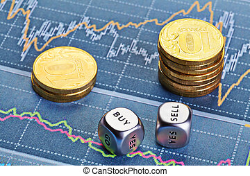 Dices cubes with words SELL BUY, stacks of coins and a up trend chart as the background. Successful trading. Selective focus