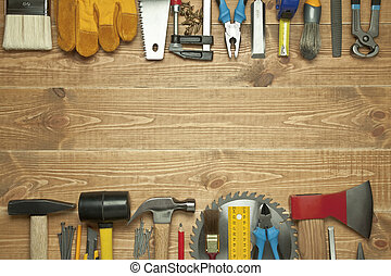 Different tools on a wooden background.