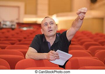 director in auditorium of movie theater