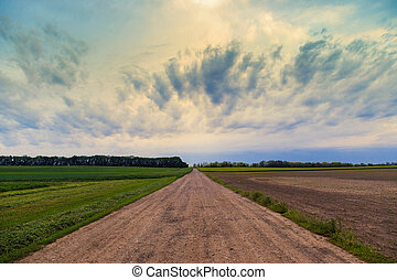 Dirty road to dramatic sky