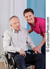 Disabled man and nurse