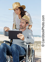 disabled man with digital tablet