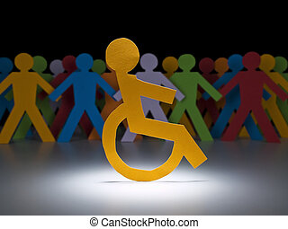 A disable paper figure stands under the spotlight on his wheelchair.