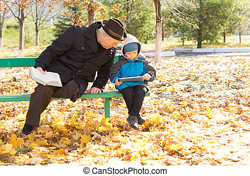 Disabled senior man with his grandson