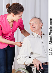 Disabled talking with a nurse