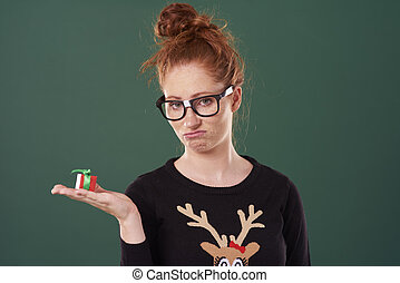 Disappointed woman holding a christmas present