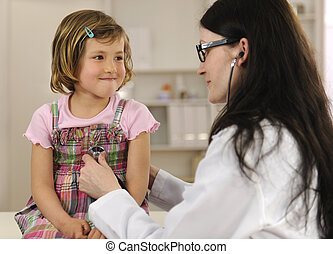 Doctor examining child at office