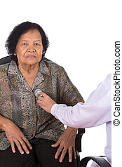 doctor listening to elderly patient's heart