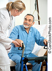 doctor or nurse helps a patient to get up in hospital