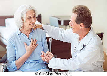 Doctor talking with old patient