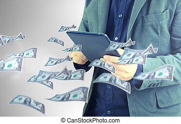 Dollar banknotes flying around businessman using digital tablet.