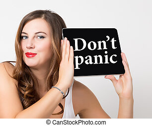 don't panic written on virtual screen. technology, internet and networking concept. beautiful woman with bare shoulders holding pc tablet