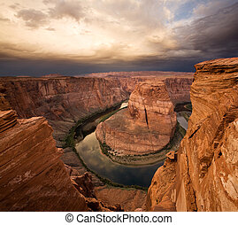 Majestic Sunrise at Horseshoe Bend, Arizona with Colorado River, adjacent to Grand Canyon National Park
