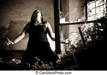 Young gothic woman in a dramatic scene.