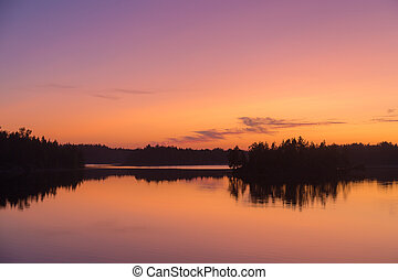 dramatic twilight on a forest lake