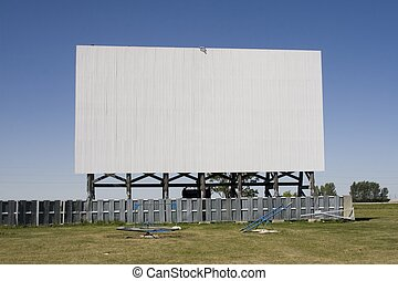 A vintage drive-in movie screen, ideal for displaying your copy or images.