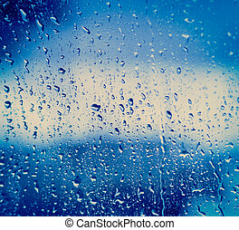 Drops Of Rain On Blue Glass Background