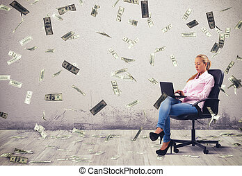 Businesswoman working at pc with banknotes background