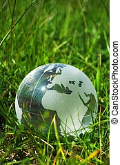 eco ecology or environmental concept with green grass globe and copyspace