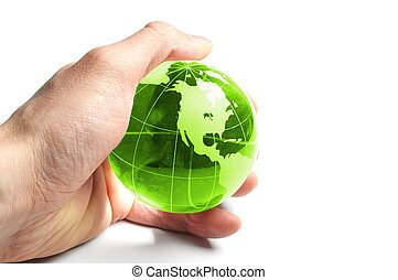 ecology concept with hand and glass globe isolated on white background
