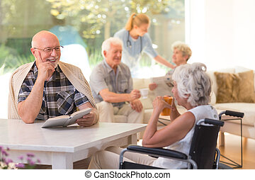 Elder talking to woman
