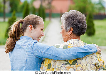 Elderly woman tell her complaints to the carer