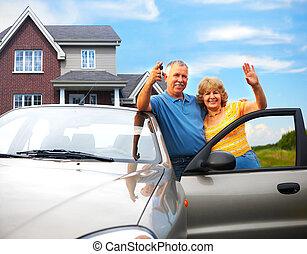 Elderly couple near their home