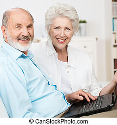 Elderly couple using a laptop computer