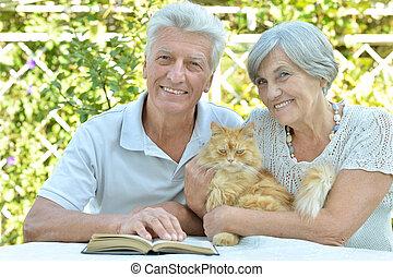 Elderly couple with cat