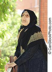 Elderly woman looking up