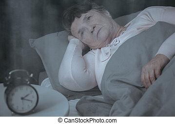 Elderly woman trying to sleep