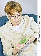 Elderly woman with pill box