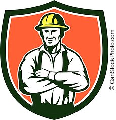 Illustration of an electrician with hat arms crossed facing front set inside shield crest on isolated background done in retro style.