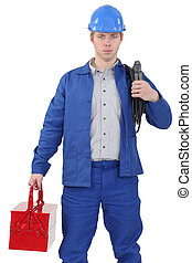 Electrician standing on white background