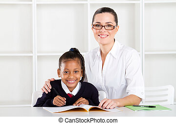 elementary teacher and student