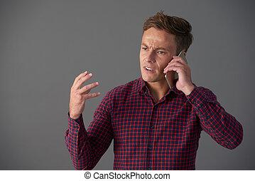 Emotional Man Talking on Phone